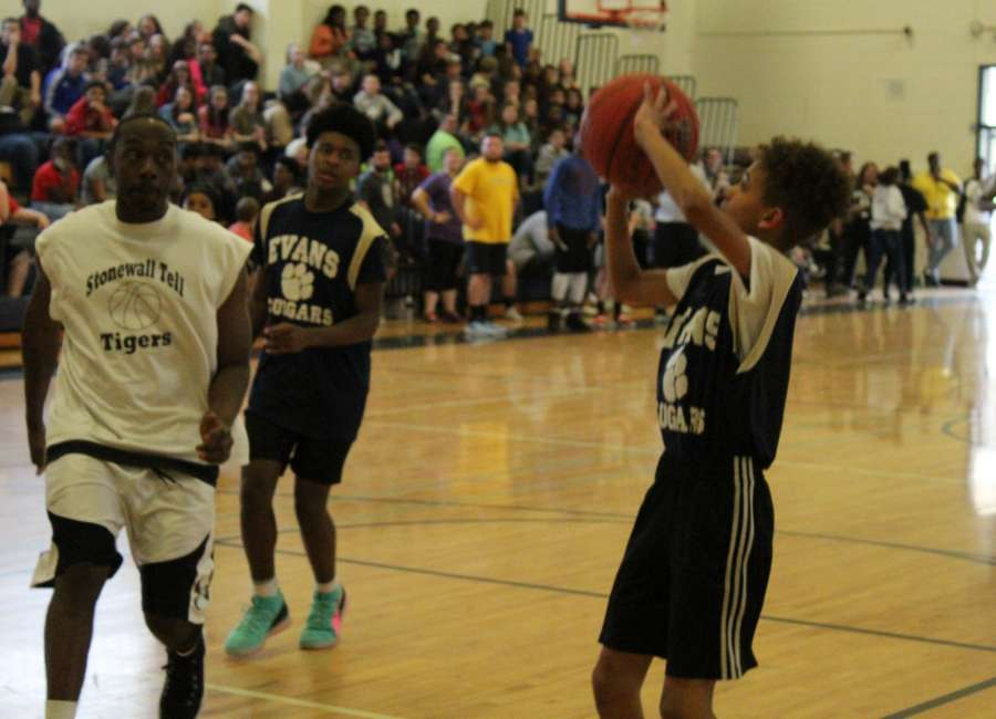 Evans Middle School students play against teachers in basketball game
