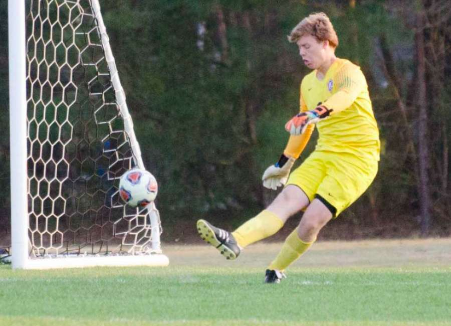 Hawks battle to finish in tough loss to five-time state champions