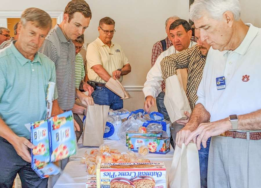 Kiwanians pack meals for area youngsters