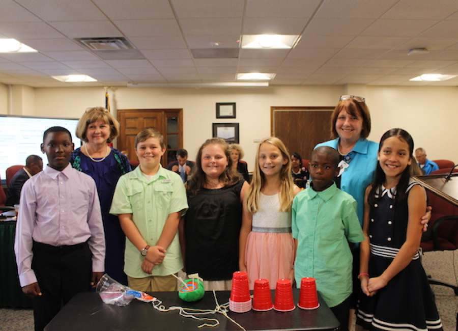 Western Elementary students present science labs to school board