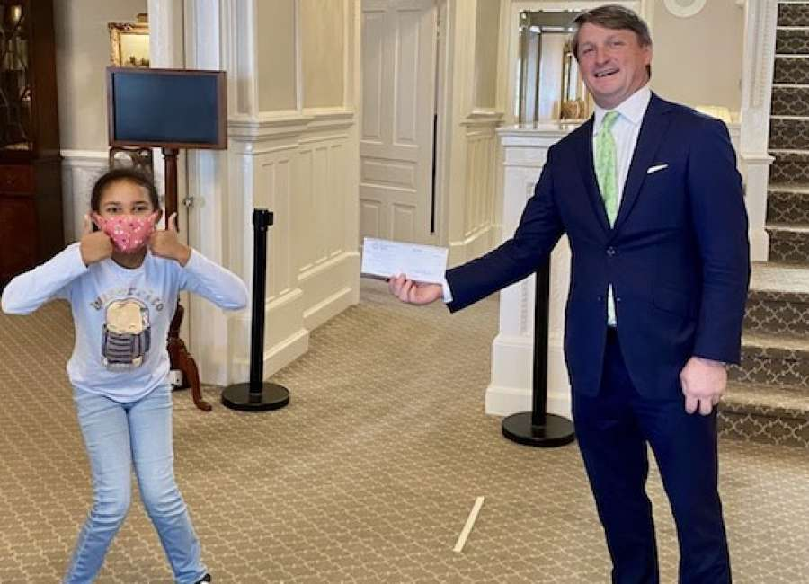 8-year-old raises more than $1,800 to spread gift of learning