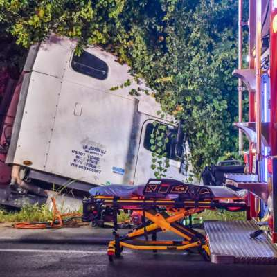 Crews rescue woman after tractor-trailer crash in Turin roundabout
