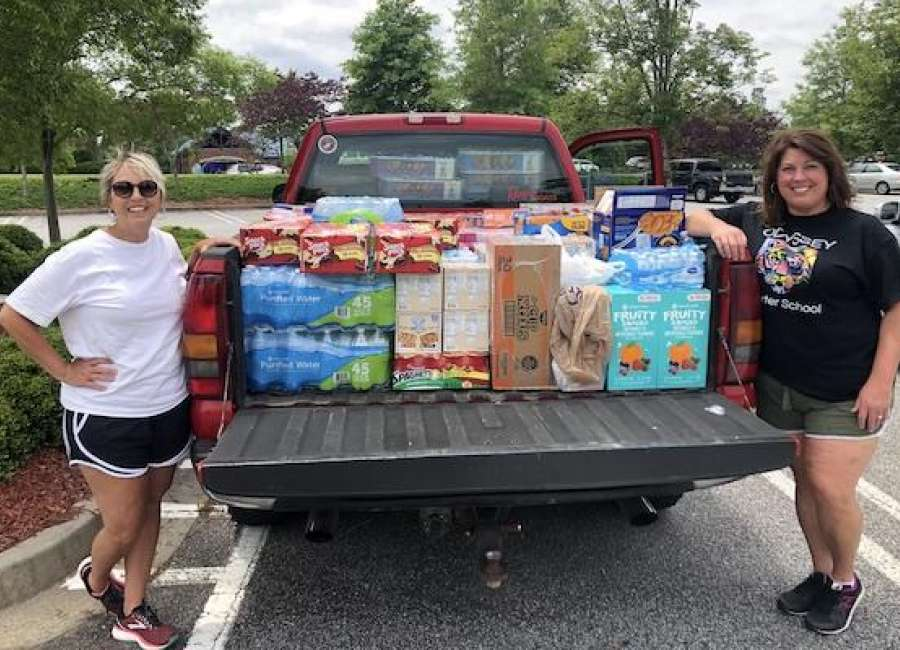 Odyssey Charter donates food for Backpack Buddies