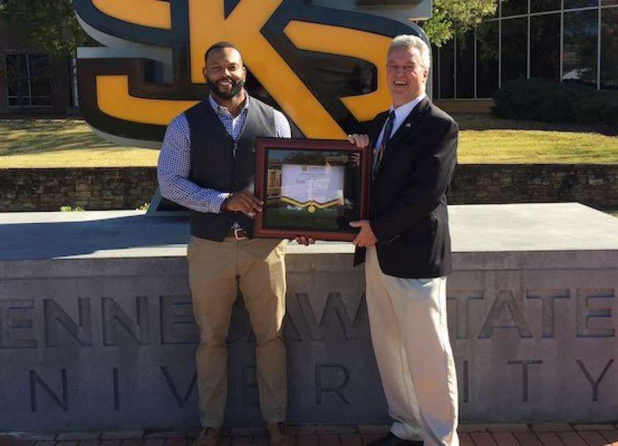 Odyssey Charter principal honored at KSU