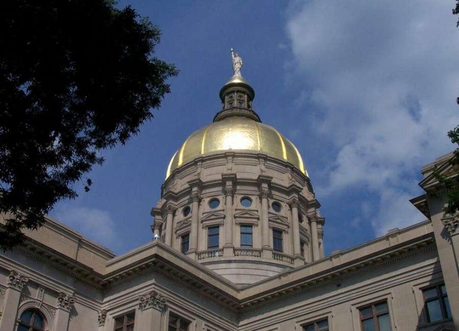Kemp signs bills to cut Georgia income tax, boost foster-care credit