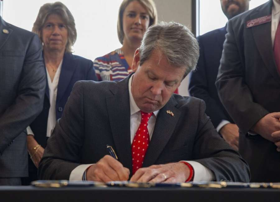 Kemp signs business bills in Cobb County ceremony